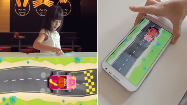 แมคฯ ใช้โต๊ะกับเทคโนโลยี NFC เป็นสนามแข่งรถไฮเทคเอาใจลูกค้าตัวน้อย!