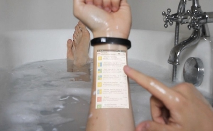 ดีไวซ์ใหม่สุดเจ๋ง Wristband ไฮเทค เปลี่ยนแขนให้เป็น Touchscreen Phone