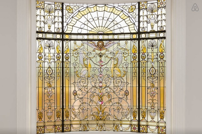while-youre-walking-around-the-mansion-you-may-notice-stained-glass-windows-like-these
