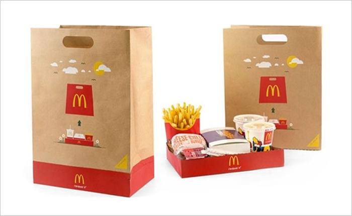 """ไอเดียแจ่ม! McDonald ออกแบบถุงใส่อาหาร ให้กลายร่างเป็น """"ถาดรอง"""" ได้ด้วย"""