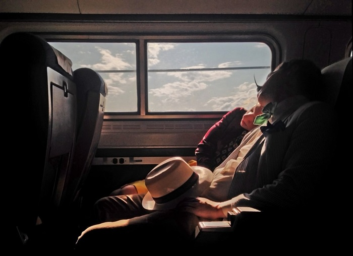 and-time-for-the-champions-yvonne-lu-captured-this-third-place-photo-while-traveling-back-to-new-york-city-on-a-train-the-couple-looks-like-they-dont-need-anything-else-in-the-worl