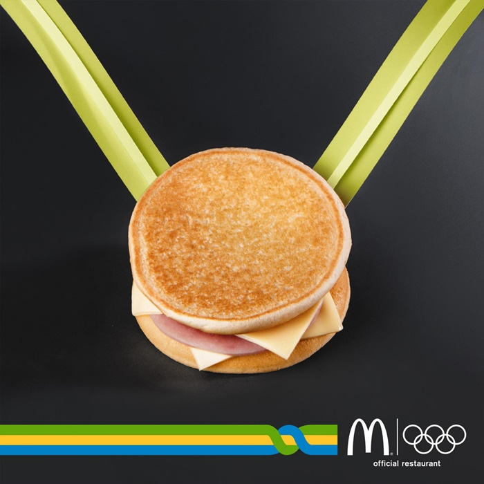 mcdonalds-medal-karate-ring-rowing-bicycle-basketball-fencing-javelin-diving-torch-print-388325-adeevee