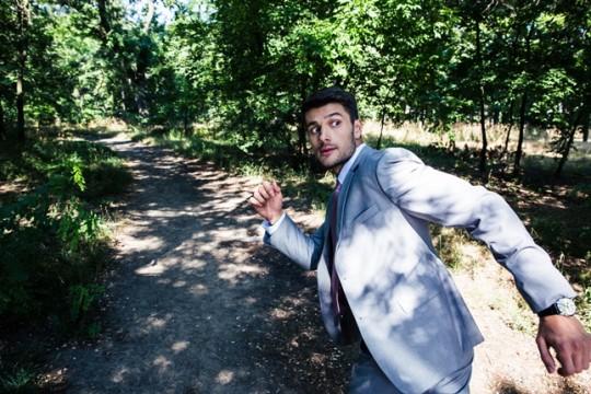 Businessman running away from something
