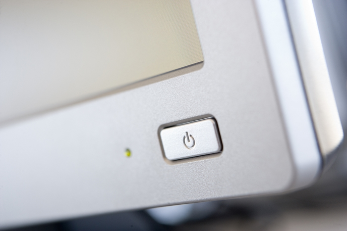 Shot of a power button on a computer monitor