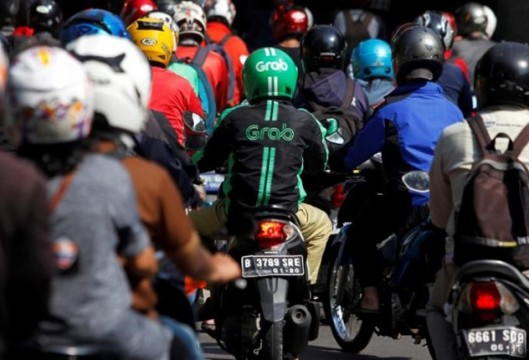 A Grab bike rider is seen during rush hour traffic in Jakarta