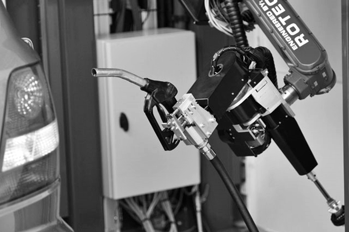 A car-fuelling robot is seen fuelling up a car in Emmeloord