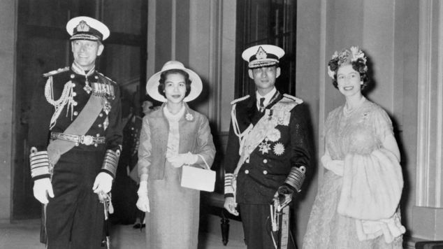 The King with his queen, Sirikit, were met by the Queen and Duke of Edinburgh